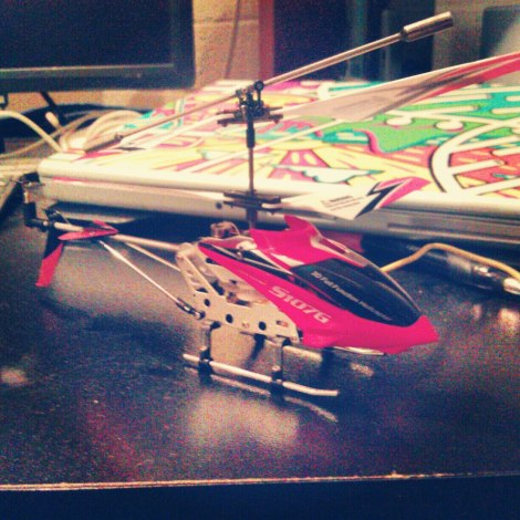 My pretty R/C helicopter with my pretty macbook pro in the background.