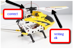 The Real Syma S107g with the small writing and correct rotor attachment. You can see the black and white nubs on the top.