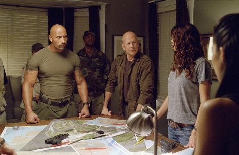 I spent a lot of this movie wondering how The Rock gets into his clothes.The rest of the time wondering how Joe ate anything in his house with all the weapons under his stuff.