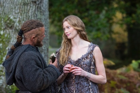 Aslaug solves Ragnar's riddle. Arriving in a net, eating an apple, and with a pup in hand.