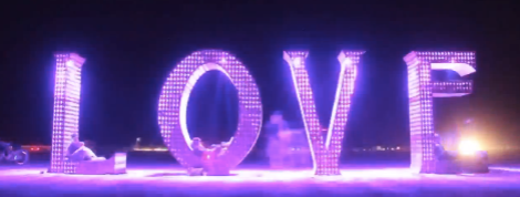 An art sculpture of love filled with neon lights.