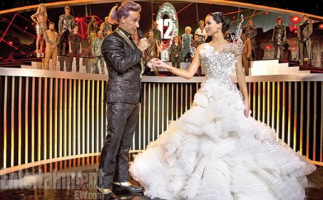 Katniss pretends to shine for the camera. [cinemablend.com]