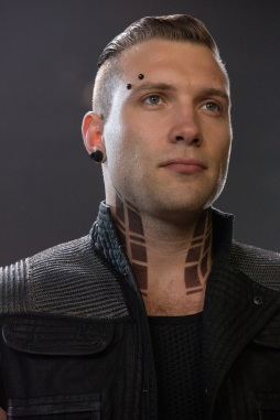 As Eric, Jai Courtney makes eyebrow piercings actually look cool. [Summit Entertainment via DivergentFaction]