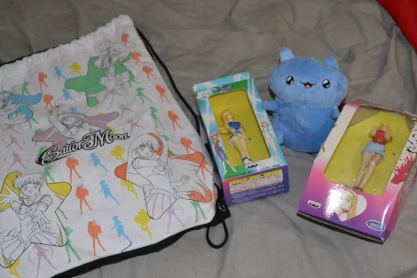 My haul from Fanime, including two Cutey Honey figurines, a Catbug plushie, and a bag to hold it all in!