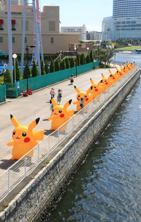 Blowup Pikachus line the water near the Cosmo Clock Ferris Wheel.